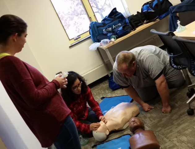Instructor training how to perform CPR